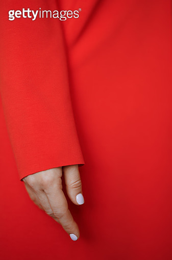 Hand of the woman in red jacket or coat. Nicely fits for book cover - gettyimageskorea