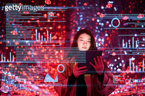young woman uses digital tablet on virtual visual screen at night - gettyimageskorea