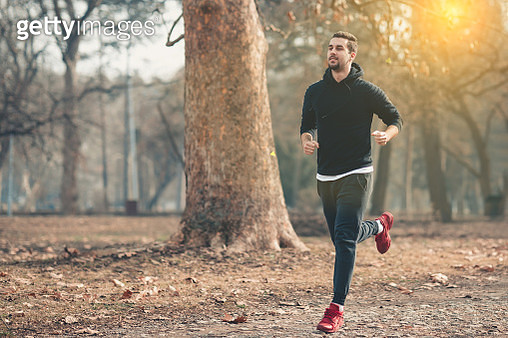 Young adult jogging in nature - gettyimageskorea