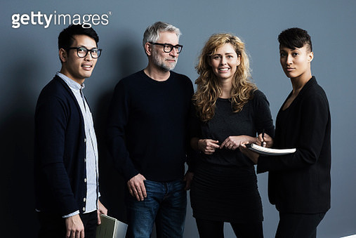Portrait of men and women holding papers - gettyimageskorea