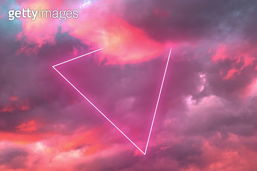 Futuristic triangle neon in the burning sky with stunning pink colors. - gettyimageskorea