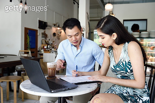 Financial advisor helping a client with paperwork - gettyimageskorea
