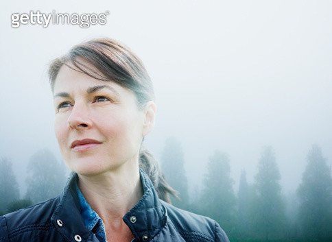 Female looking to horizon in rural scene - gettyimageskorea