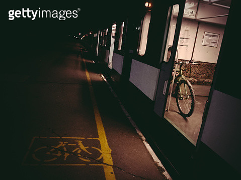 Bicycle sign on platform ground next to train with bicycle inside - gettyimageskorea