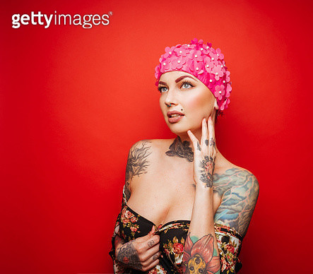 Beautiful Tattoo Model with Pink Bathing Cap - gettyimageskorea