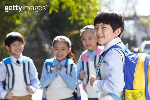 Carrying bags of primary school pupils - gettyimageskorea