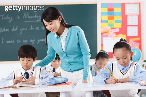 The teacher and pupil in the class - gettyimageskorea