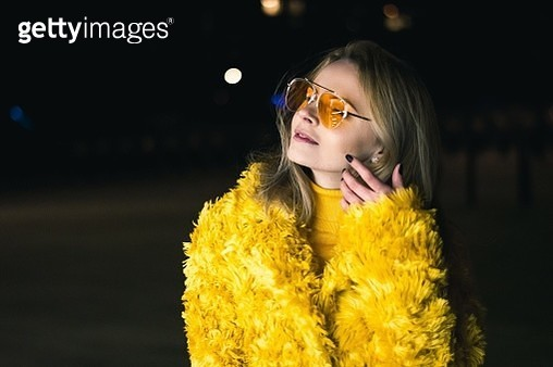 Close-Up Woman In Sunglasses And Yellow Dress At Night - gettyimageskorea