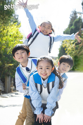 Carrying bags of primary school pupils - gettyimageskorea
