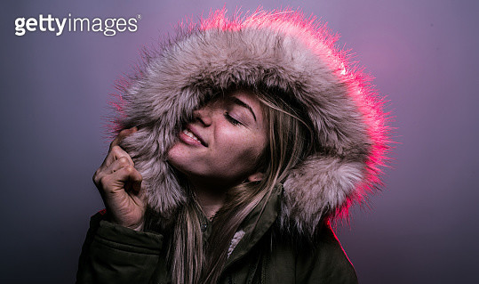 Close-Up Of Woman Wearing Fur Coat Against Gray Background - gettyimageskorea