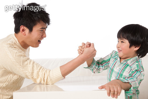 Father and son in an arm-wrestling - gettyimageskorea