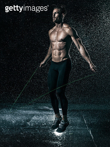 MId adult man, outdoors, skipping in rain - gettyimageskorea