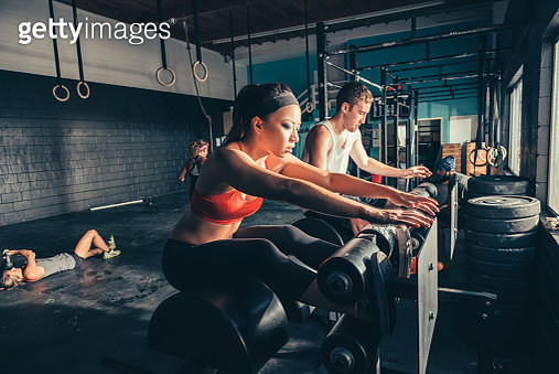 People training on exercise equipment in gym - gettyimageskorea