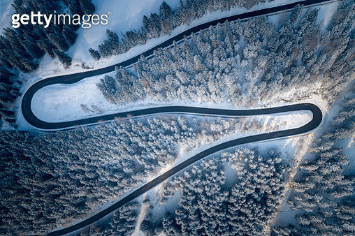 Aerial View Of Winding Road During Winter - gettyimageskorea