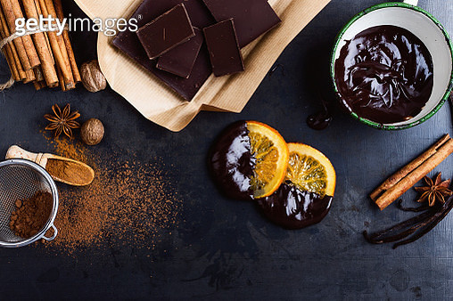 Melted dark chocolate, glaceed orange slices and spices - gettyimageskorea