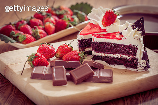 Close-Up Of Cakes With Chocolates And Strawberries On Table - gettyimageskorea