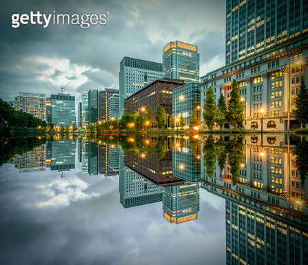 Tokyo Cityscape with skyscrapers and office buildings illuminated reflection in Hibiya, Marunouchi, Otemachi, Chiyoda ward, Japan at night. - gettyimageskorea
