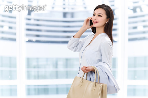 Young woman make a phone call - gettyimageskorea