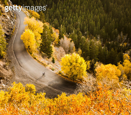 Aerial view of bicyclist on rural road - gettyimageskorea