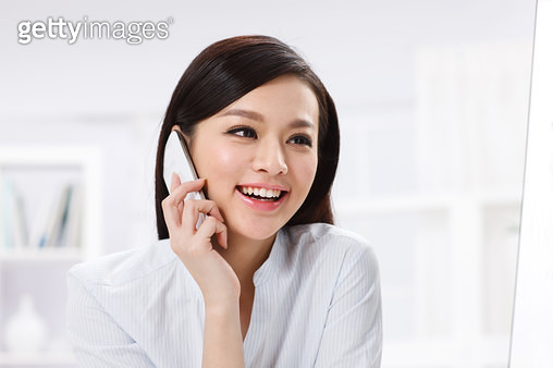 Young business woman make a phone call - gettyimageskorea