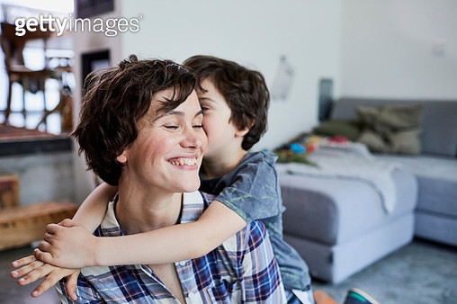 Mother and son at home, son hugging mother - gettyimageskorea