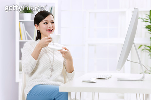 Young business woman drink coffee - gettyimageskorea