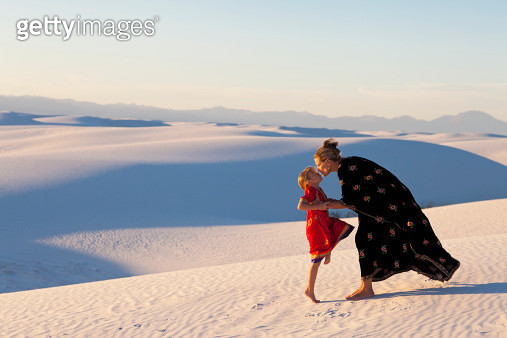 Caucasian mother and daughter kissing in desert - gettyimageskorea