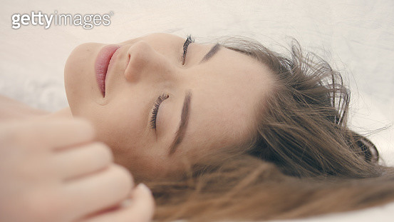 Young, beautiful woman dragging out in bed. Peaceful monring - gettyimageskorea