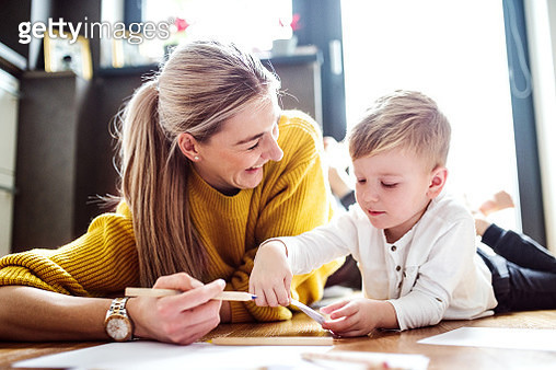 Happy woman with her son at home. - gettyimageskorea