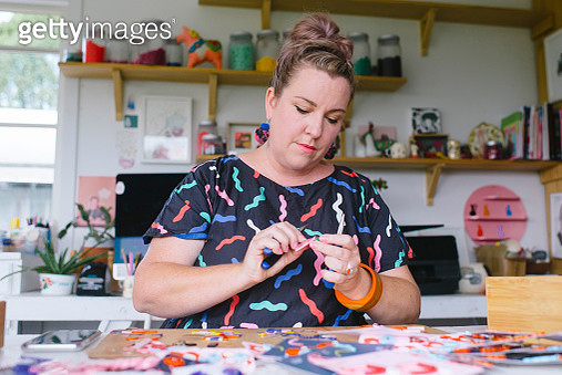 Mature adult female small business owner and designer working in studio office - gettyimageskorea
