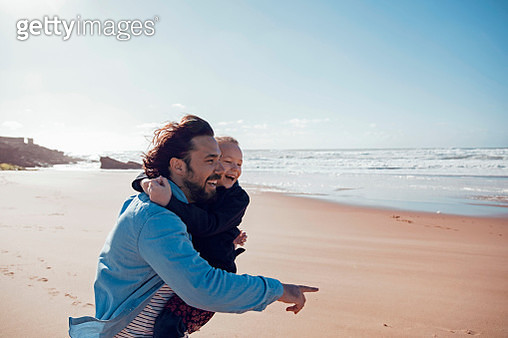 Father and daughter on the beach - gettyimageskorea