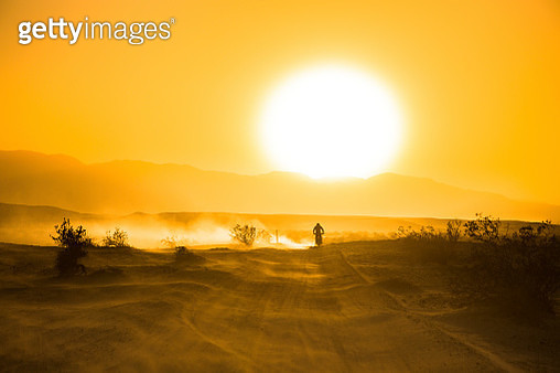 A desert camping trip in the Anza Borrego Occotillo Wells region of the California desert. RV's, motorcycles, and dune buggies gather together in a community. - gettyimageskorea