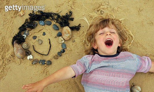 Face in the sand - gettyimageskorea