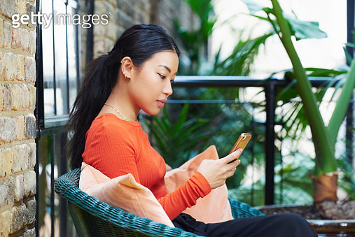 woman texting on mobile phone - gettyimageskorea