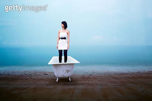 Woman Standing In Bathtub At Beach - gettyimageskorea