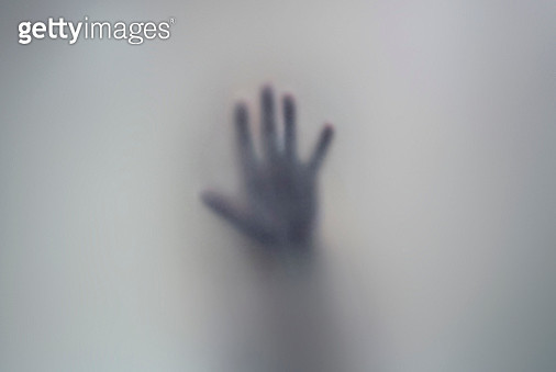Human hand seen through a frosted glass. - gettyimageskorea