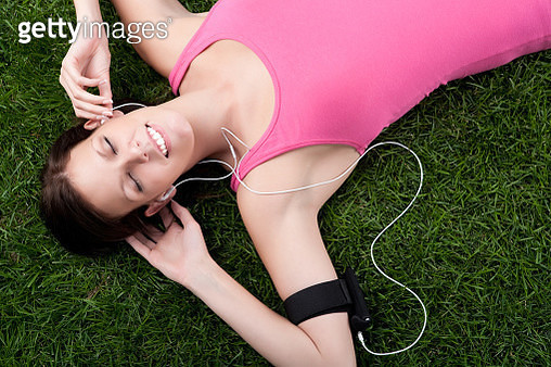 Woman relaxing on grass - gettyimageskorea