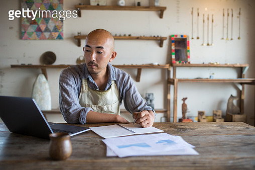 A shopkeeper doing his monthly financial planning and bookkeeping - gettyimageskorea