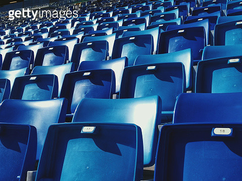 Empty blue arena seats with numbers in a stadium - gettyimageskorea