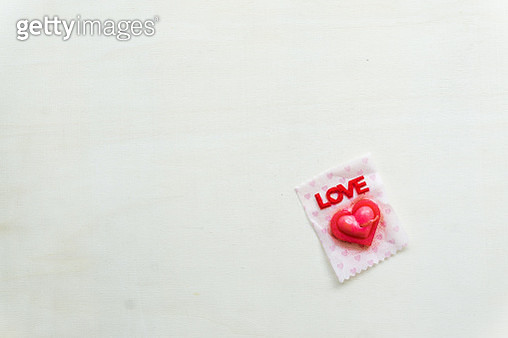 High Angle View Of Heart Shape Candy With Love Text On Table - gettyimageskorea