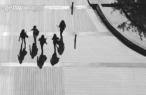 High Angle View Of Women Walking On Footpath - gettyimageskorea