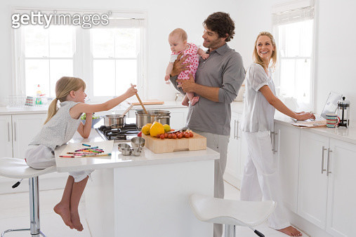 A family in a kitchen - gettyimageskorea