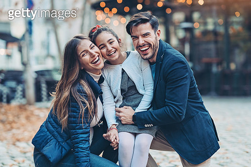 Portrait of young family with small daughter - gettyimageskorea
