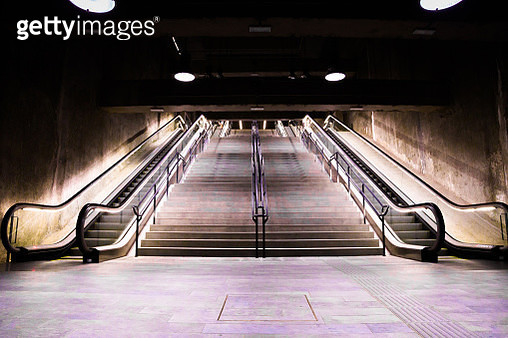 Beautiful subway facilities with escalators and stairs without people and futuristic architecture. - gettyimageskorea