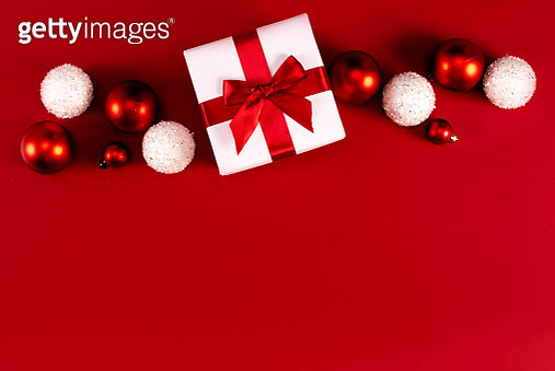 Christmas gift box and balls on red background - gettyimageskorea