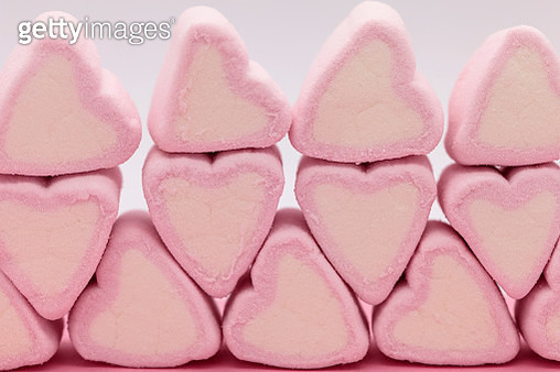 Close-Up Of Pink Heart Shaped Marshmallows On Table - gettyimageskorea