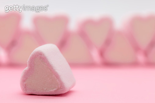Close-Up Of Pink Heart Shaped Marshmallows On Table Against White Background - gettyimageskorea