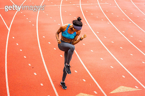 Happy Black athlete celebrating on track - gettyimageskorea