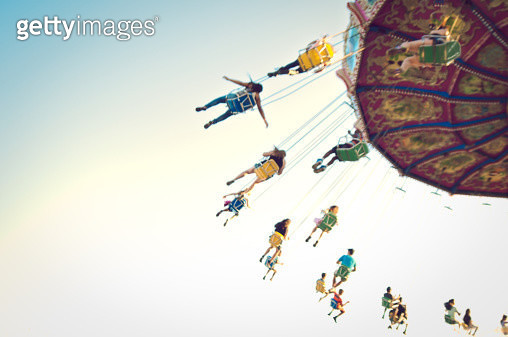 People on Swing Ride - gettyimageskorea