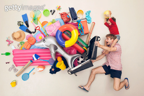 Germany, Artificial scene with man opening baggage full of beach toys - gettyimageskorea